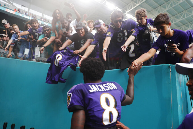Baltimore Ravens quarterback Lamar Jackson (8) is cheered by fans as he exits the field, at the end of an NFL football game, Sunday, Sept. 8, 2019, in Miami Gardens, Fla. The Ravens defeated the Dolphins 59-10. (AP Photo/Brynn Anderson)