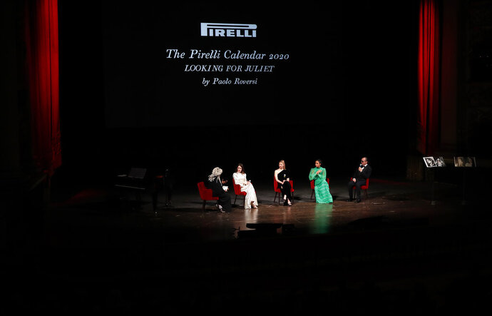 From left, Whoopi Goldberg, British actress Claire Foy, British model Mia Goth,  American model Yara Shahidi and photographer Paolo Roversi attend the 2020 Pirelli Calendar event in Verona, Italy, Tuesday, Dec. 3, 2019. (AP Photo/Antonio Calanni)