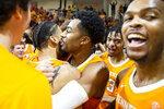 Tennessee players swarm guard Lamonte Turner (1) celebrating his hitting the winning shot at the buzzer in the Emerald Coast Classic against Virginia Commonwealth in Niceville, Fla., Saturday, Nov. 30, 2019. Tennessee defeated Virginia Commonwealth 72-69. (AP Photo/Mark Wallheiser)