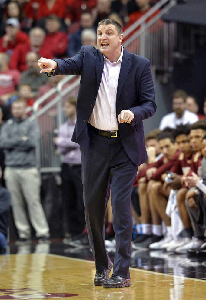 Boston College head coach Jim Christian instructs his team during the first half of an NCAA college basketball game against Louisville in Louisville, Ky., Wednesday, Jan. 16, 2019. (AP Photo/Timothy D. Easley)