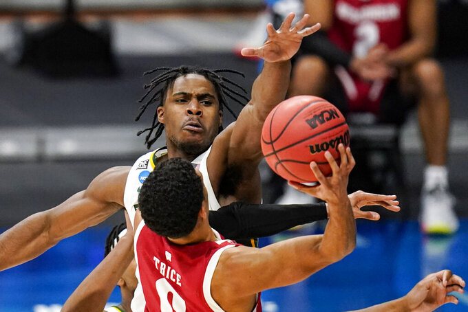 Baylor guard Davion Mitchell (45) blocks the shot of Wisconsin guard D'Mitrik Trice (0) in the second half of a second-round game in the NCAA men's college basketball tournament at Hinkle Fieldhouse in Indianapolis, Sunday, March 21, 2021. (AP Photo/Michael Conroy)