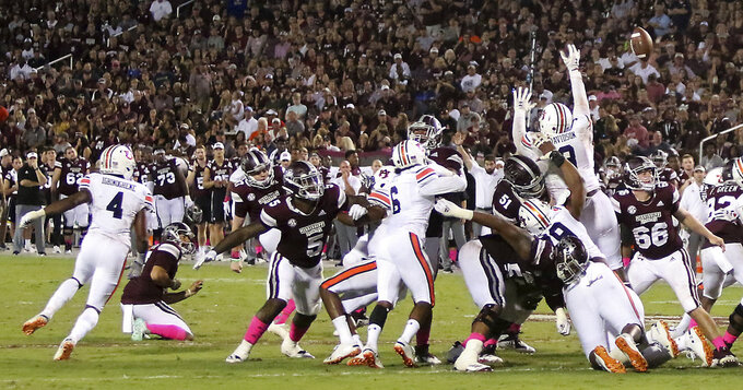 Auburn defensive lineman Marlon Davidson (3) blocks a Mississippi State field goal during the second half of an NCAA college football game Saturday, Oct. 6, 2018, in Starkville, Miss. MSU won 23-9. (AP Photo/Jim Lytle)