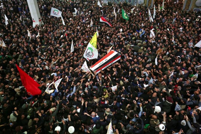 Mourners carry the coffins of Iran's Gen. Qassem Soleimani and Abu Mahdi al-Muhandis, deputy commander of Iran-backed militias at the Imam Ali shrine in Najaf, Iraq, Saturday, Jan. 4, 2020. Iran has vowed
