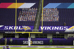 FILE - Cutouts of Minnesota Vikings fans are shown in the stands of US Bank Stadium during the second half of an NFL football game between the Atlanta Falcons and Minnesota Vikings in Minneapolis, in this Sunday, Oct. 18, 2020, file photo. The eight teams hosting NFL playoff games this month are more than happy to be staying home with all of comfort it brings, but the actual advantage of playing there all but disappeared during this pandemic season of mostly empty stadiums.(AP Photo/Bruce Kluckhohn, File)