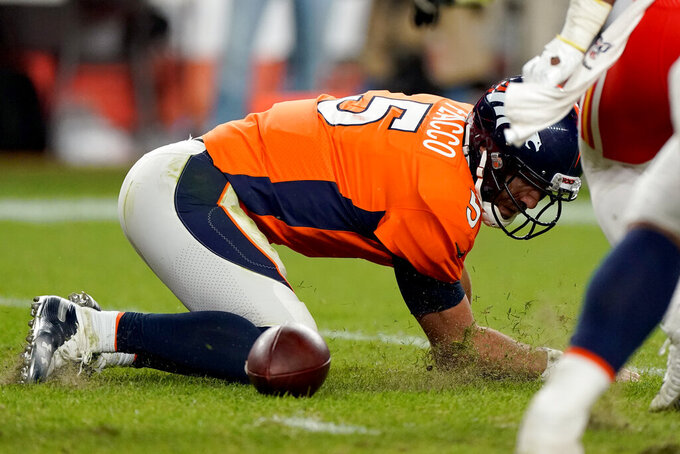 Denver Broncos quarterback Joe Flacco (5) falls after being sacked against the Kansas City Chiefs during the second half of an NFL football game, Thursday, Oct. 17, 2019, in Denver. (AP Photo/Jack Dempsey)