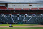 Grounds crew work on the field following the announcement that the Toronto Blue Jays will play their 2020 home games at Sahlen Field, their Triple-A affiliate, Friday, July 24, 2020, in Buffalo N.Y. (AP Photo/Jeffrey T. Barnes)