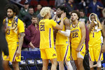 Minnesota's Jarvis Omersa (21) consoles teammates following their 70-50 loss to Michigan State in a second-round men's college basketball game in the NCAA Tournament in Des Moines, Iowa, Saturday, March 23, 2019. (AP Photo/Nati Harnik)