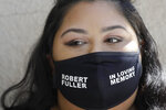 A mourner wears a mask in honor of Robert Fuller during his funeral Tuesday, June 30, 2020, in Littlerock, Calif. Fuller, a 24-year-old Black man was found hanging from a tree in a park in a Southern California high desert city. Authorities initially said the death of Fuller appeared to be a suicide but protests led to further investigation, which continues. (AP Photo/Marcio Jose Sanchez)
