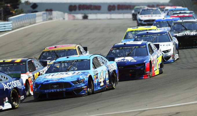 Kevin Harvick (4) Alex Bowman (88) head into Turn 1 during a NASCAR Cup Series auto race at Watkins Glen International, Sunday, Aug. 4, 2019, in Watkins Glen, N.Y. (AP Photo/John Munson)
