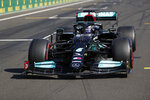 Mercedes driver Lewis Hamilton of Britain after he clocked the fastest time during the qualifying session for the Hungarian Formula One Grand Prix, at the Hungaroring racetrack in Mogyorod, Hungary, Saturday, July 31, 2021. The Hungarian Formula One Grand Prix will be held on Sunday. (David W Cerny/Pool via AP)