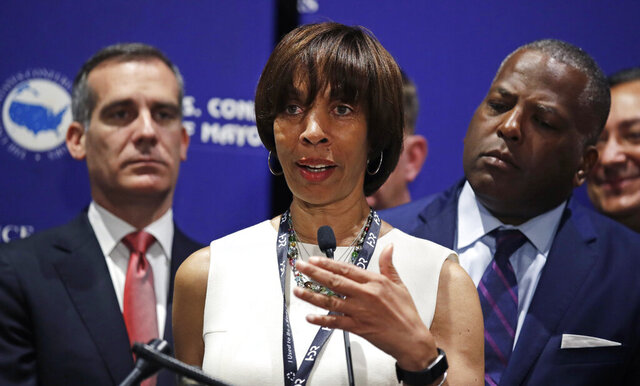 FILE - In this June 8, 2018, file photo, Baltimore Mayor Catherine Pugh addresses a gathering during the annual meeting of the U.S. Conference of Mayors in Boston. The disgraced former mayor of Baltimore is scheduled to be sentenced during a hearing on Thursday, Feb. 27, 2020.  (AP Photo/Charles Krupa, File)