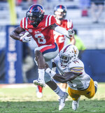 Mississippi wide receiver Elijah Moore (8) is tackled by Louisiana Monroe linebacker David Griffith (14)  during an NCAA college football game at Vaught-Hemingway Stadium in Oxford, Miss. on Saturday, Oct. 6, 2018. (Bruce Newman/The Oxford Eagle via AP)
