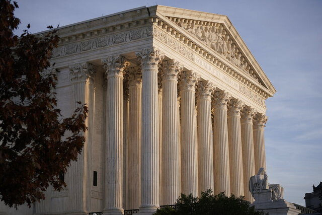 In this Nov. 5, 2020 file photo, The Supreme Court is seen in Washington.  The Supreme Court has dismissed as premature a challenge to President Donald Trump's plan to exclude people living in the country illegally from the population count used to allot states seats in the House of Representatives. But the court's decision Friday is not a final ruling on the matter and it's not clear whether Trump will receive final numbers from the Census Bureau before he leaves office next month. (AP Photo/J. Scott Applewhite)