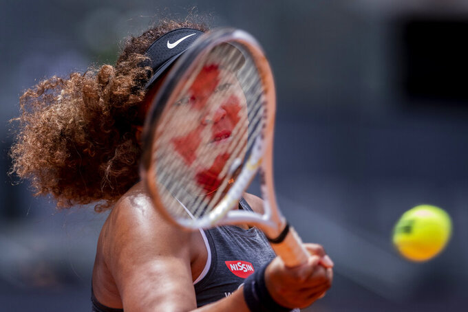 Japan's Naomi Osaka returns the ball to Japan's Misaki Doi during their match at the Mutua Madrid Open tennis tournament in Madrid, Spain, Friday, April 30, 2021. (AP Photo/Bernat Armangue)