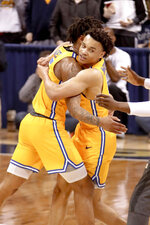 Pittsburgh's Trey McGowens, right, and Au'Diese Toney (5) celebrate as time runs out during the second half of an NCAA college basketball game against Notre Dame, Saturday, March 9, 2019, in Pittsburgh. Pittsburgh won 56-53. (AP Photo/Keith Srakocic)