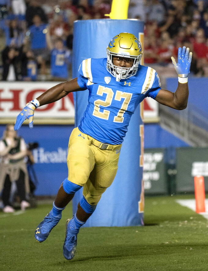 UCLA running back Joshua Kelley celebrates his touchdown during the first half of an NCAA college football game against Utah Friday, Oct. 26, 2018, in Pasadena, Calif. (AP Photo/Kyusung Gong)