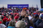 Supporters of President Donald Trump cheer as he speaks during a campaign rally at Muskegon County Airport, Saturday, Oct. 17, 2020, in Norton Shores, Mich. (AP Photo/Alex Brandon)