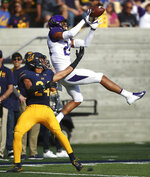 Washington's Ty Jones, right, leaps for a catch against California's Camryn Bynum during the first half of an NCAA college football game Saturday, Oct. 27, 2018, in Berkeley, Calif. (AP Photo/Ben Margot)
