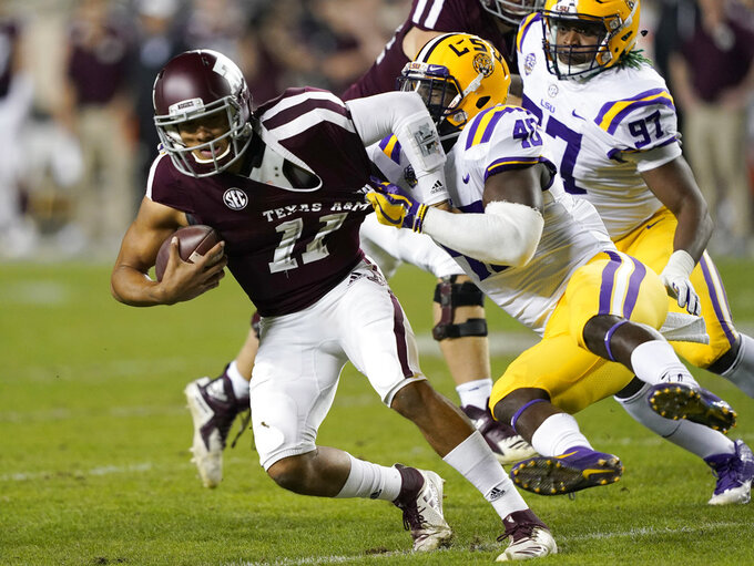 Texas A&M quarterback Kellen Mond (11) is sacked by LSU linebacker Devin White (40) during the first half of an NCAA college football game Saturday, Nov. 24, 2018, in College Station, Texas. (AP Photo/David J. Phillip)