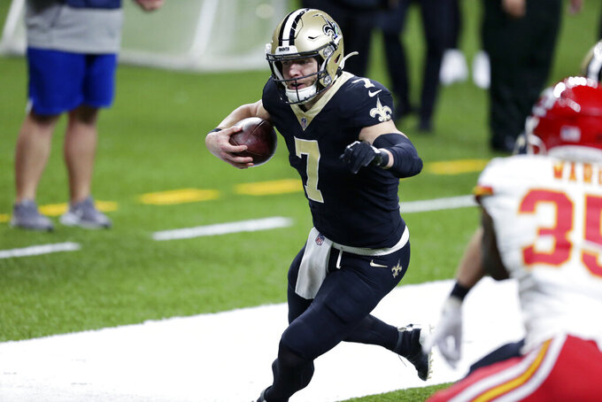 New Orleans Saints quarterback Taysom Hill (7) carries near the goal line in the first half of an NFL football game against the Kansas City Chiefs in New Orleans, Sunday, Dec. 20, 2020. (AP Photo/Butch Dill)