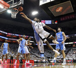 North Carolina guard Cameron Johnson (13) attempts to block the shot of Louisville guard Darius Perry (2) during the second half of an NCAA college basketball game in Louisville, Ky., Saturday, Feb. 2, 2019. North Carolina won 79-69. (AP Photo/Timothy D. Easley)