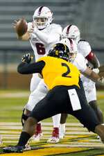 Florida Atlantic quarterback Nick Tronti (6) takes a snap as Southern Mississippi defensive lineman Eriq Kitchen (2) rushes during the second half of an NCAA college football game Thursday, Dec. 10, 2020, in Hattiesburg, Miss. (AP Photo/Rogelio V. Solis)