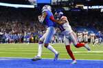 Detroit Lions wide receiver Kenny Golladay (19), defended by New York Giants free safety Antoine Bethea (41) catches 41-yard pass for a touchdown during the second half of an NFL football game, Sunday, Oct. 27, 2019, in Detroit. (AP Photo/Paul Sancya)