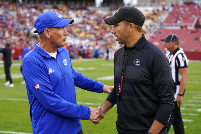 Kansas head coach Lance Leipold greets Iowa State head coach Matt Campbell, right, before an NCAA college football game, Saturday, Oct. 2, 2021, in Ames, Iowa. (AP Photo/Charlie Neibergall)
