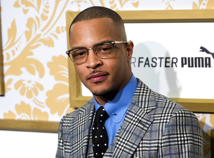 FILE - In this Jan. 27, 2018 file photo, T.I. attends the Roc Nation pre-Grammy brunch in New York. Police say rapper T.I. has been arrested for disorderly conduct and public drunkenness as he tried to enter his gated community outside Atlanta. Henry County Police Deputy Mike Ireland said T.I. was arrested around 4:30 a.m. Wednesday, May 16, after he got into an argument with a security guard. Media reports say the rapper, whose real name is Clifford Harris, lost his key and the guard wouldn't let him into the community. (Photo by Charles Sykes/Invision/AP, File)