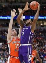 Northwestern center Dererk Pardon, right, shoots against Illinois forward Giorgi Bezhanishvili during the first half of an NCAA college basketball game in the first round of the Big Ten Conference tournament in Chicago, Wednesday, March 13, 2019. (AP Photo/Nam Y. Huh)