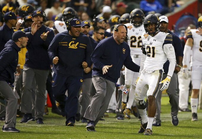 California safety Evan Rambo (21) celebrates his tackle for a loss against TCU with some of the coaches during the first half of the Cheez-It Bowl NCAA college football game Wednesday, Dec. 26, 2018, in Phoenix. (AP Photo/Ross D. Franklin)