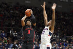 Houston's Nate Hinton (11) shoots over Connecticut's Brendan Adams (10) in the second half of an NCAA college basketball game, Thursday, March 5, 2020, in Storrs, Conn. (AP Photo/Jessica Hill)