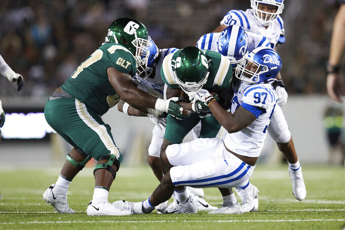 Charlotte running back Shadrick Byrd (13) is tackled by Duke defensive end Caleb Oppan (97) during an NCAA college football game Friday, Sept. 3, 2021, in Charlotte, N.C. (AP Photo/Brian Westerholt)