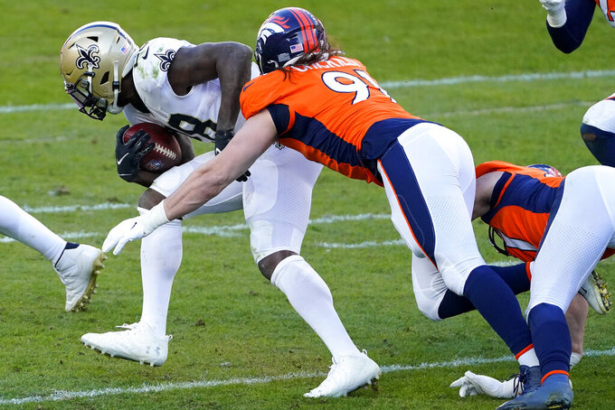 New Orleans Saints running back Latavius Murray is tackled by Denver Broncos linebacker Anthony Chickillo, right, during the first half of an NFL football game, Sunday, Nov. 29, 2020, in Denver. (AP Photo/Jack Dempsey)