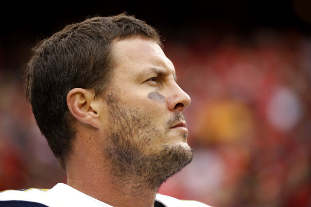 FILE - In this Dec. 29, 2019, file photo Los Angeles Chargers quarterback Philip Rivers stands for the national anthem before an NFL football game against the Kansas City Chiefs in Kansas City, Mo. Rivers' career with the Los Angeles Chargers has come to an end. The franchise announced Monday, Feb. 10, 2020, that Rivers will enter free agency and not return for the upcoming season. (AP Photo/Charlie Riedel, File)