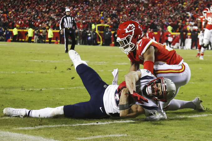 New England Patriots wide receiver Julian Edelman (11) makes a catch against Kansas City Chiefs cornerback Charvarius Ward (35) during the first half of the AFC Championship NFL football game, Sunday, Jan. 20, 2019, in Kansas City, Mo. (AP Photo/Elise Amendola)