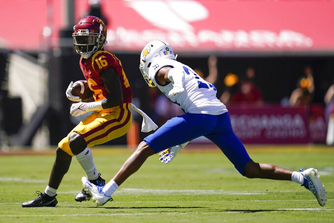 Southern California cornerback Prophet Brown (16) is tackled by San Jose State cornerback Nehemiah Shelton (23) during an NCAA college football game Saturday, Sept. 4, 2021, in Los Angeles. (AP Photo/Ashley Landis)