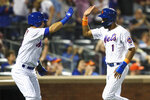 New York Mets' Amed Rosario (1) celebrates with Sam Haggerty after scoring on a on a three-run double pinch hit by Rajai Davis during the eighth inning of a baseball game against the Los Angeles Dodgers, Saturday, Sept. 14, 2019, in New York. (AP Photo/Mary Altaffer)