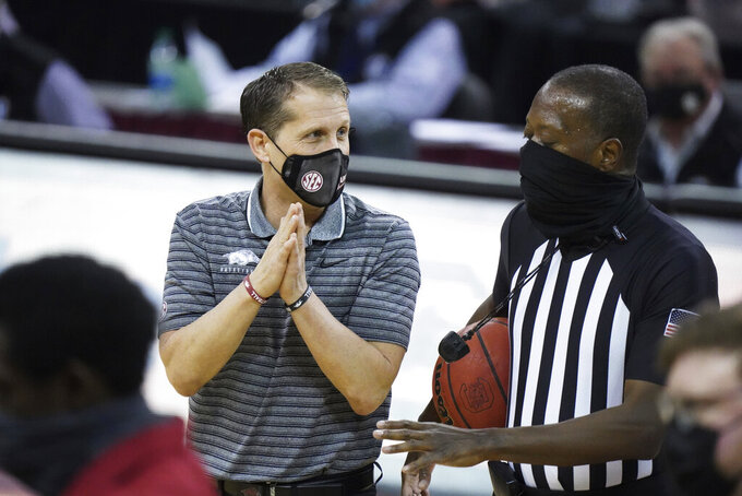 Arkansas coach Eric Musselman talks with an official during the first half of the team's NCAA college basketball game against South Carolina on Tuesday, March 2, 2021, in Columbia, S.C. (AP Photo/Sean Rayford)