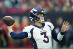 Denver Broncos quarterback Drew Lock (3) passes against the Houston Texans during the first half of an NFL football game Sunday, Dec. 8, 2019, in Houston. (AP Photo/David J. Phillip)
