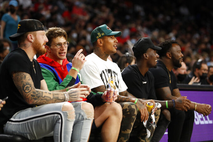 Members of the Las Vegas Raiders watch the Las Vegas Aces take on the Phoenix Mercury in Game 1 in the semifinals of the WNBA playoffs Tuesday, Sept. 28, 2021, in Las Vegas. From left: Maxx Crosby, Foster Moreau, Darren Waller and Bryan Edwards. Raiders alumni Marcel Reece is at far right. (AP Photo/Steve Marcus)