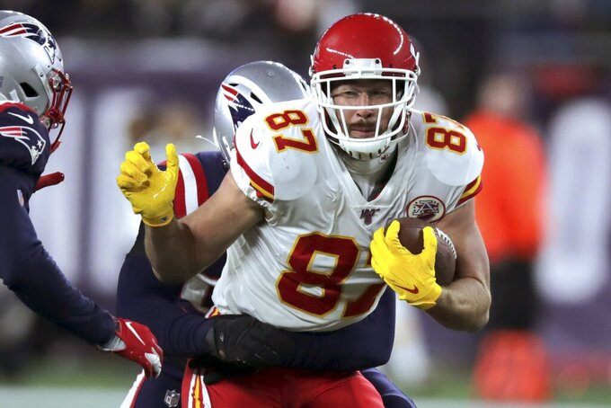 Kansas City Chiefs tight end Travis Kelce carries the ball after catching a pass in the first half of an NFL football game against the New England Patriots, Sunday, Dec. 8, 2019, in Foxborough, Mass. (AP Photo/Charles Krupa)
