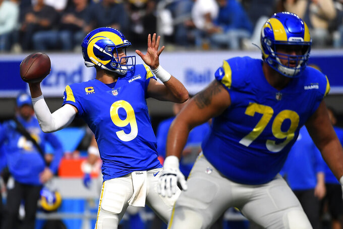 Los Angeles Rams quarterback Matthew Stafford throws a pass during the first half of an NFL football game against the Detroit Lions Sunday, Oct. 24, 2021, in Inglewood, Calif. (AP Photo/Kevork Djansezian)