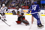 Chicago Blackhawks goaltender Corey Crawford (50) stops Toronto Maple Leafs centre Auston Matthews (34) during second period NHL hockey action in Toronto, Saturday, Jan. 18, 2020. (Cole Burston/The Canadian Press via AP)