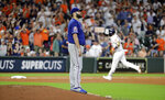 Texas Rangers starting pitcher Lance Lynn, left, looks toward the outfield as Houston Astros Yuli Gurriel runs the bases after hitting a home run during the fifth inning of a baseball game Tuesday, Sept. 17, 2019, in Houston. (AP Photo/David J. Phillip)