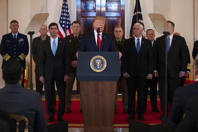 President Donald Trump addresses the nation from the White House on the ballistic missile strike that Iran launched against Iraqi air bases housing U.S. troops, Wednesday, Jan. 8, 2020, in Washington, as Secretary of Defense Mark Esper, Chairman of the Joint Chiefs of Staff Gen. Mark Milley, Vice President Mike Pence, and Secretary of State Mike Pompeo, and others look on. (AP Photo/ Evan Vucci)