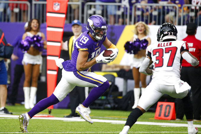Minnesota Vikings wide receiver Adam Thielen (19) runs from Atlanta Falcons free safety Ricardo Allen (37) during a 23-yard touchdown reception in the first half of an NFL football game, Sunday, Sept. 8, 2019, in Minneapolis. (AP Photo/Bruce Kluckhohn)