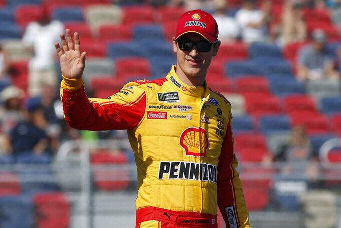 Joey Logano during driver introductions prior to the NASCAR Cup Series auto race at ISM Raceway, Sunday, Nov. 10, 2019, in Avondale, Ariz. (AP Photo/Ralph Freso)