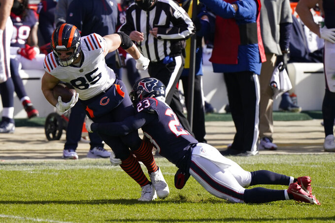 Chicago Bears' Cole Kmet (85) is tackled by Houston Texans' Eric Murray (23) during the first half of an NFL football game, Sunday, Dec. 13, 2020, in Chicago. (AP Photo/Nam Y. Huh)