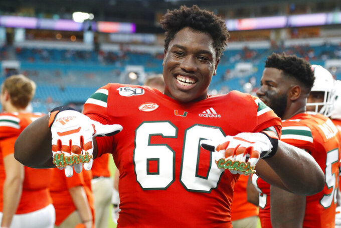 "Miami offensive lineman Zion Nelson celebrates wearing ""touchdown rings"" after scoring during the second half of an NCAA college football game against Bethune-Cookman, Saturday, Sept. 14, 2019, in Miami Gardens, Fla. (AP Photo/Wilfredo Lee)"